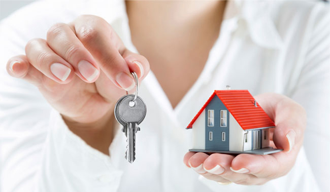 Image shows woman holding keys - protect your Liverpool rental investment with our landlord insurance.
